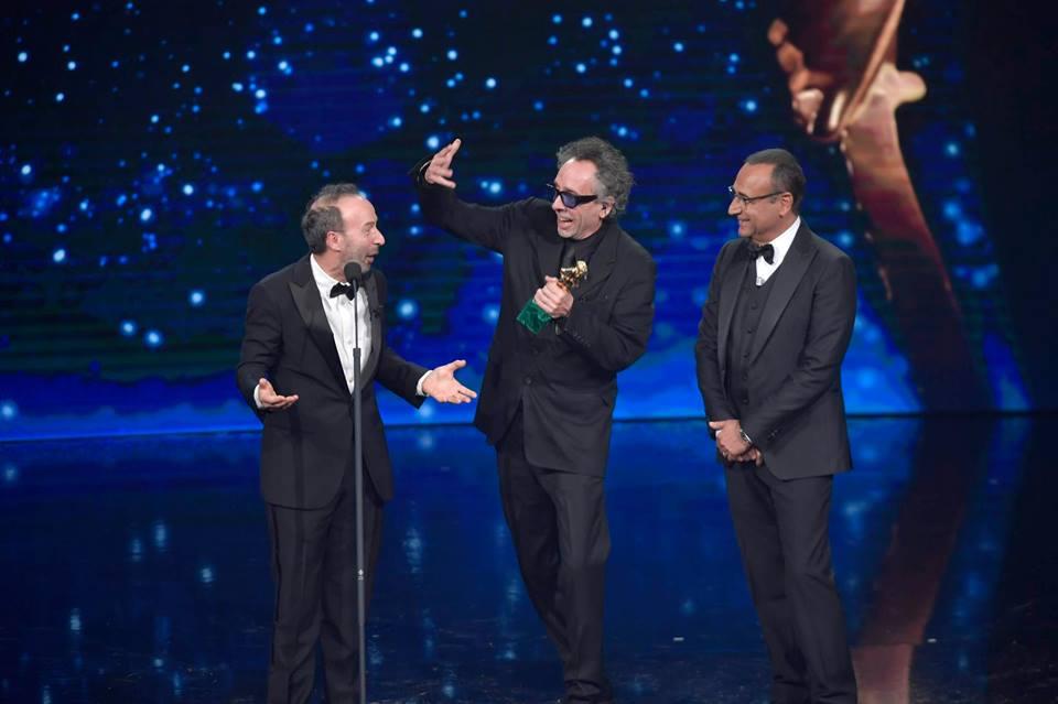 Dogman si consacra miglior film dell'anno e si aggiudica ben nove statuette. Professionale e cordiale come sempre Carlo Conti